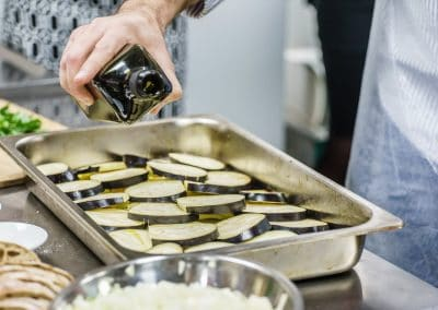 chef making moussaka